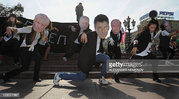 Activists of the proKremlin youth movement 'Nashi' and 'Young Russia' perform wearing masks of Russia's opposition leaders former Duma speaker Sergei...