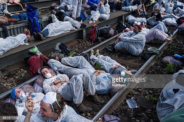 Activists of the protest association 'Ende Gelaende' sitting on the train tracks towards the Vattenfall power plant in Welzow Germany 14 May 2016 The...
