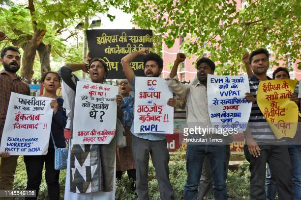 Activists of the Revolutionary Workers Party of India hold up placards as they protest outside the Election Commission office in New Delhi India on...