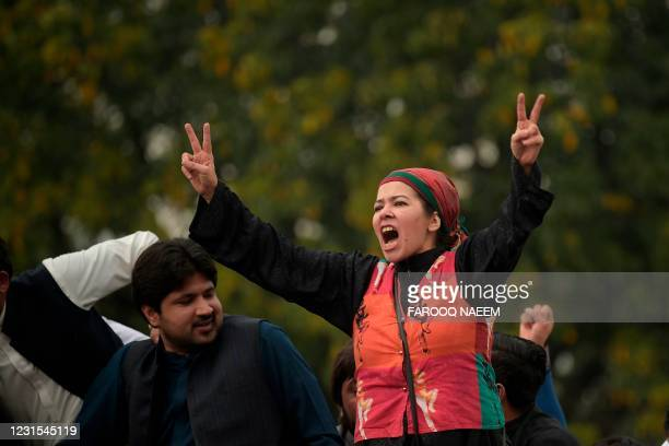 Activists of the ruling Pakistan Tehreek Insaf shout slogans as they gather outside the National Assembly during a vote of confidence session for...