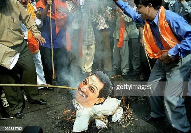 Activists of the Shiva Sena party burn an effigy of former Indian cricket captain Mohammad Azharuddin in New Delhi 04 November 2000 who was named in...
