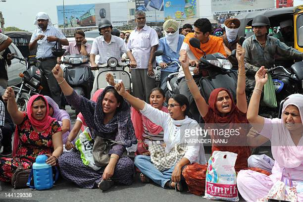 Activists of the Special Trainer Teacher Union shout slogans during a protest against Punjab state chief minister Parkash Singh Badal and Punjabi...