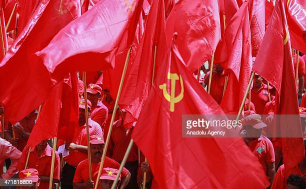 Activists of the Sri Lankan Marxist political party Peoples' Liberation Front march during a rally to mark International Labor Day in Colombo Sri...