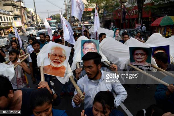 Activists of the Students Federation of India walking towards Brahmaputra river to immerse of Prime Minister of India, Chief Minister of Assam and...