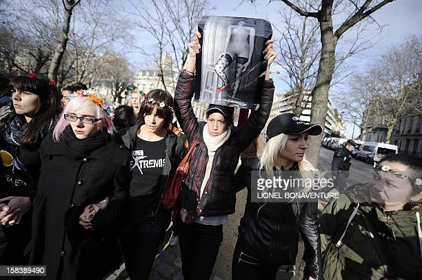 Activists of the Ukrainian women movement Femen demonstrate near the Egyptian embassy in Paris on December 15 2012 to support Aliaa Magda Elmahdy an...