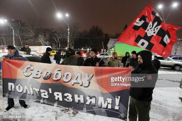 Activists of the UNAUNSO Ukrainian nationalists organization are seen holding a banner saying Freedom to the political prisoners during a rally...