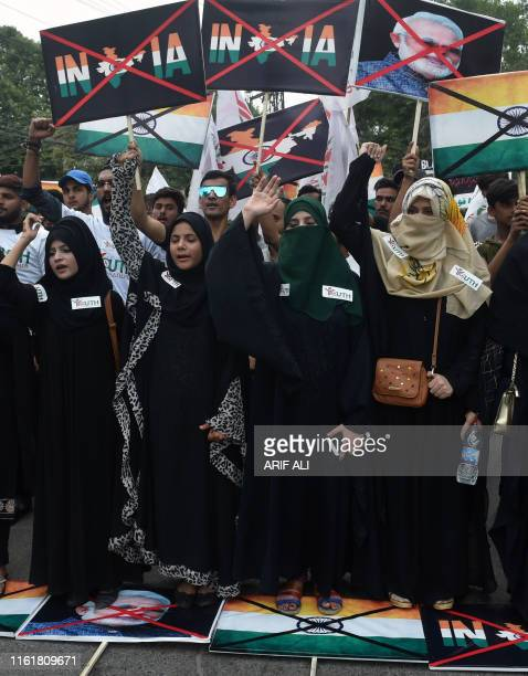 Activists of the 'Youth Forum for Kashmir' group shout antiIndian slogans during a protest in Lahore on August 15 2019 as the country observes 'Black...