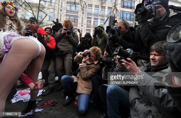 Activists of Ukrainian womens' movement FEMEN shout and gesture on February 14 2011 during a protest called Italiy is not a brothel in front of the...