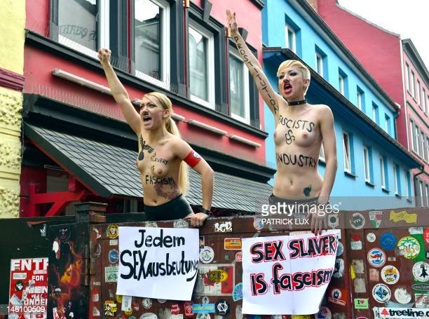 Activists of Ukraninan feminist group FEMEN demonstrate in the red light district Reeperbahn in Hamburg on June 10, 2012. The group calls the sex...