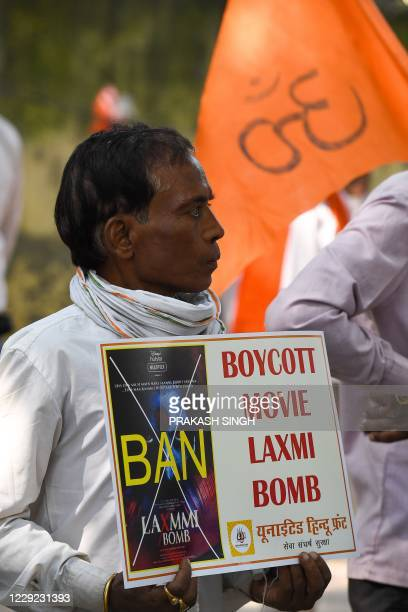 Activists of United Hindu Front hold placards during a protest to demand the ban of Bollywood movie Laxmi Bomb for using Goddess Laxmi name as film...