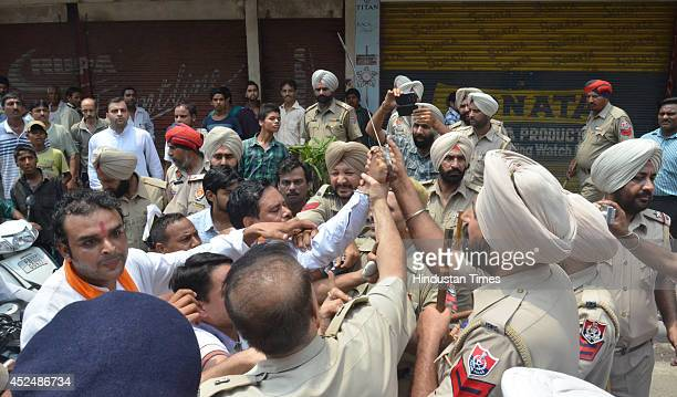 Activists of various Hindu organizations clash with police during their protest in front of historical mosque Khairudeen at Hall Bazar against the...