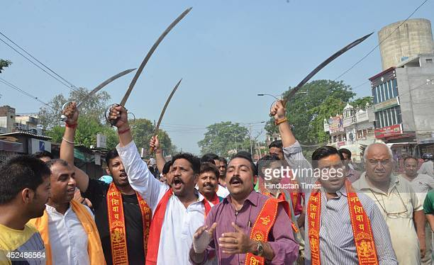 Activists of various Hindu organizations during their protest against the Jammu and Kashmir government on July 21 2014 in Amritsar India A bandh was...