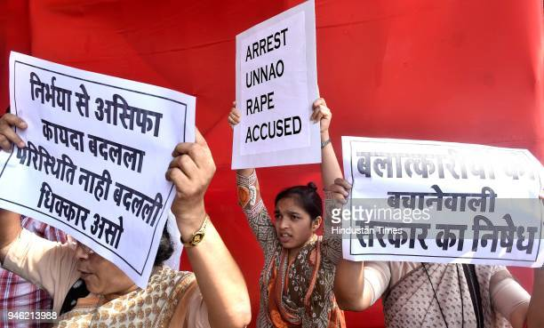 Activists of various organisations protest and demanded justice for rape and murder victims of Unnao Kathua cases at Azad Maidan on April 13 2018 in...