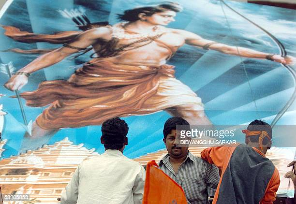 Activists of Vishwa Hindu Parishad or World Hindu Council errect a billboard depicting an image of the Hindu God Ram during a protest rally in...