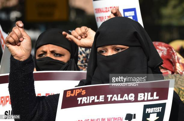 Activists of Women India Movement shout slogans as they hold placards against proposed 'Triple Talaq Bill' during a protest in New Delhi on January 4...
