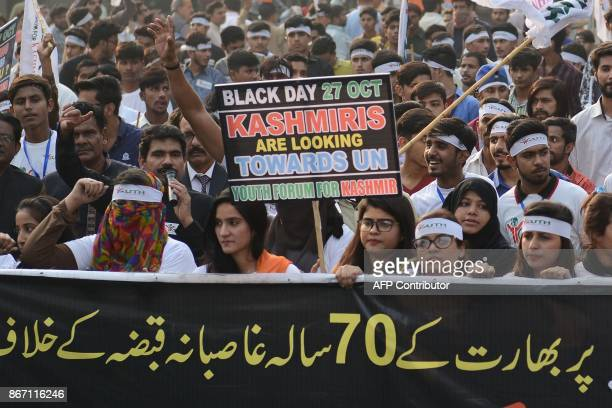 Activists of Youth Forum for Kashmir march during a protest in Lahore on October 27 2017 Kashmiris protesters are observing 'Black Day' to mark the...