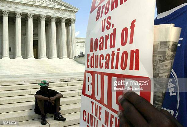 Activists organized by BAMN rally in front of the US Supreme Court to mark the anniversary of the Brown vs Board of Education decision May 15 2004 in...