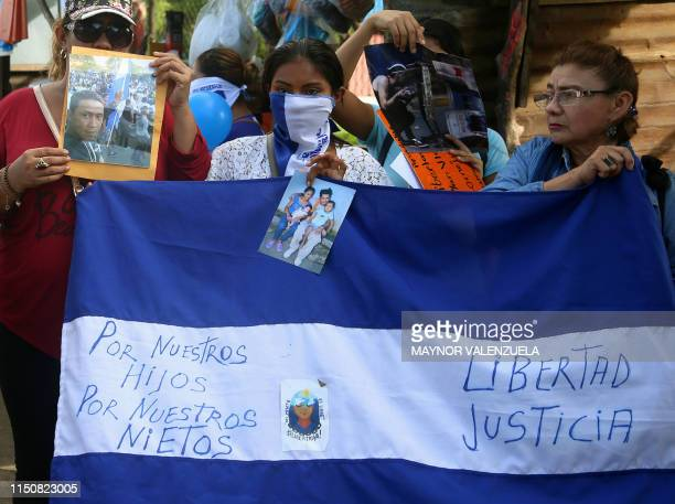 Activists participate in a demonstration to ask for the release of political prisoners outside 'La Modelo' prison, in Tipitapa, on June 19, 2019. -...