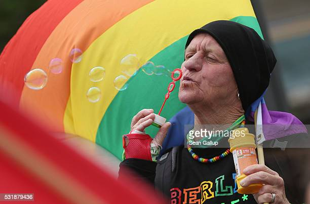 Activists participate in a gathering to promote The International Day Against Homophobia, Transphobia and Biphobia on May 17, 2016 in Berlin,...