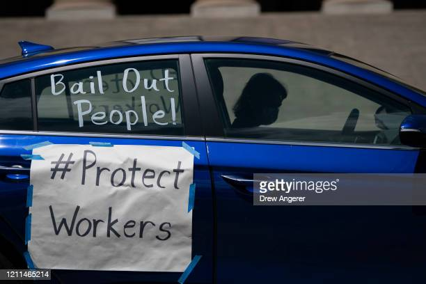 Activists participate in a May Day protest while driving in their vehicles during the coronavirus pandemic, May 1, 2020 Washington, DC. May 1st marks...