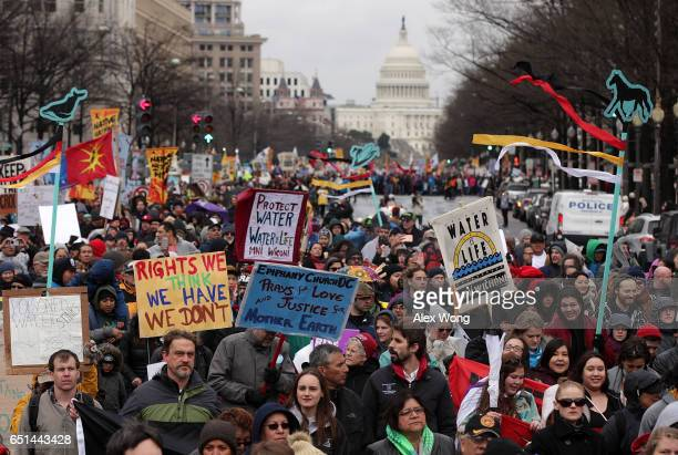 Activists participate in a protest against the Dakota Access Pipeline March 10, 2017 in Washington, DC. The Standing Rock Sioux Tribe held the event...