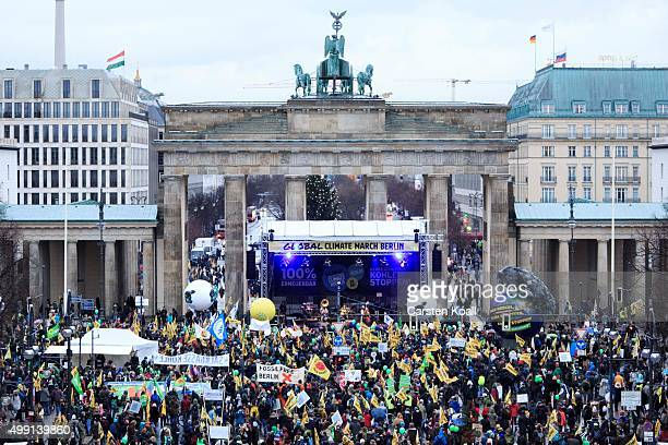 Activists participate in the Global Climate March in front of the Brandenburger Tor on November 29 2015 in Berlin Germany The COP21 2015 Paris...