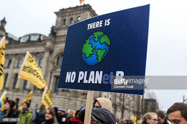 Activists participate in the Global Climate March in front of the Reichstag Building on November 29 2015 in Berlin Germany The COP21 2015 Paris...
