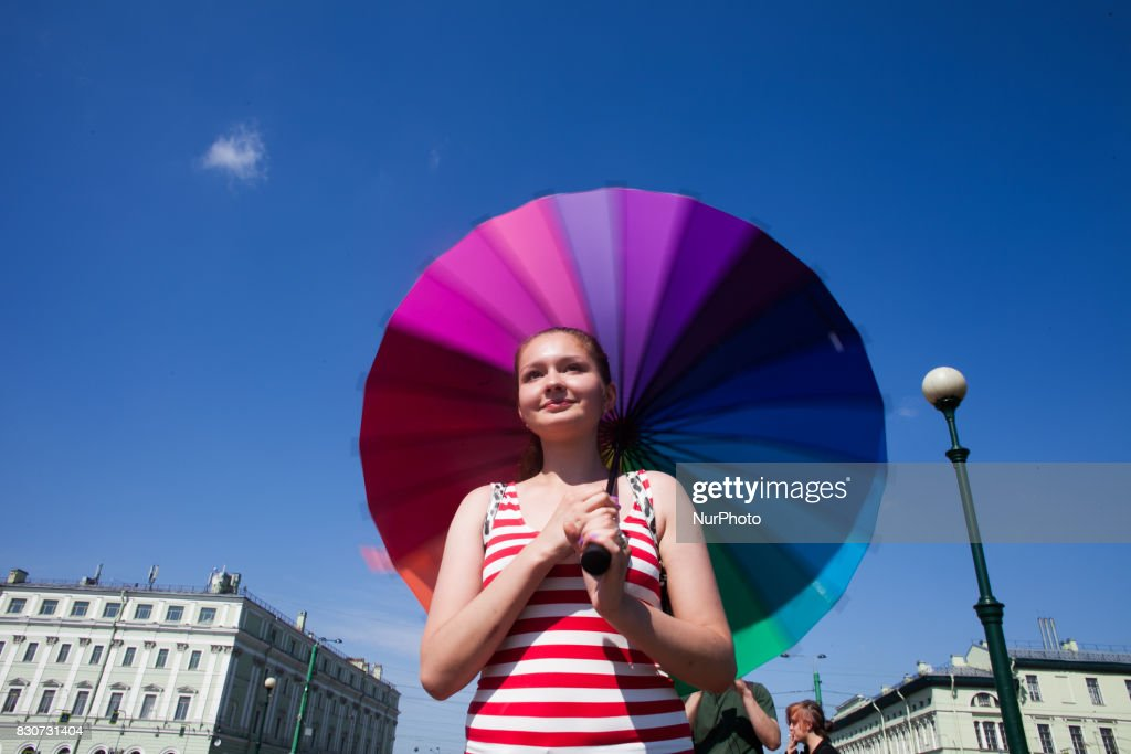 Activists participate in the St Petersburg LGBT Pride march on august 12, 2017