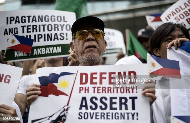 Activists participate on a protest in front of the Chinese Consular office in Manila on July 12 to mark the second anniversary of a UNbacked tribunal...