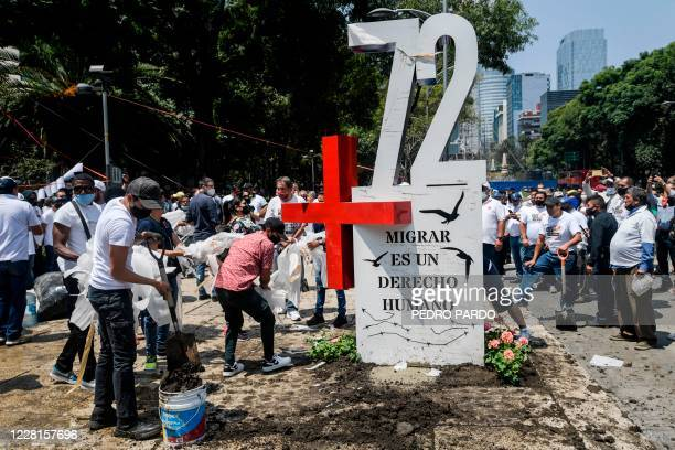 "Activists place an ""anti-monument"" to mark the 10th anniversary of the San Fernando Massacre in which 72 migrants on route to the United States were..."