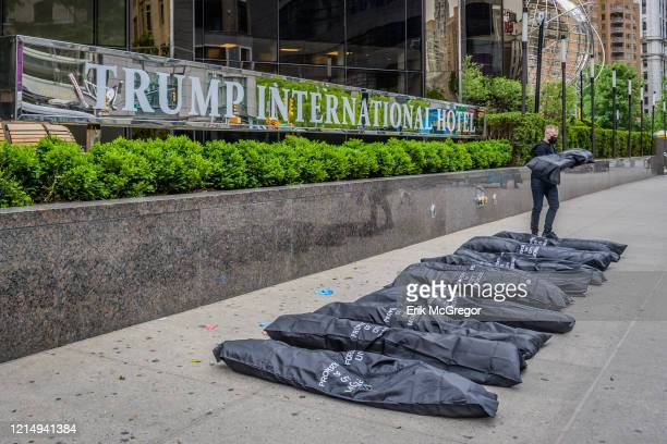 Activists placed body bags outside Trump International Hotel and Tower to draw attention to Trump and the GOP's dereliction of duty to prevent...