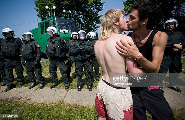 Activists pose in front of Riot police as they block the road on June 07 2007 near Hinter Bollhagen close to Heiligendamm Germany Several thousand...