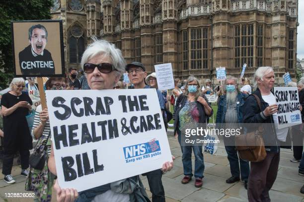 Activists protest about the Health and Care bill outside of Parliament on July 14, 2021 in London, England. Parliament held the second reading of the...