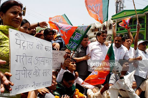 Activists protest against recent petrol hike at Sector 22 on May 24, 2012 in Noida, India. Activists shouted slogans against UPA government &...