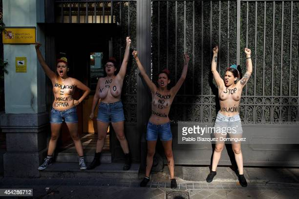 Activists protest against the recent cases of sexual violence and rapes against women, with body painting reading 'Rape = Spain Brand', 'It is not',...