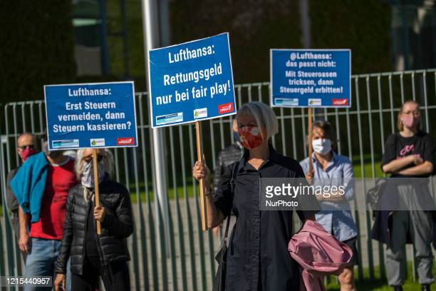 Activists protest against the recent German Government's Lufthansa bailout in front of the Chancellery in Berlin Germany on May 27 2020