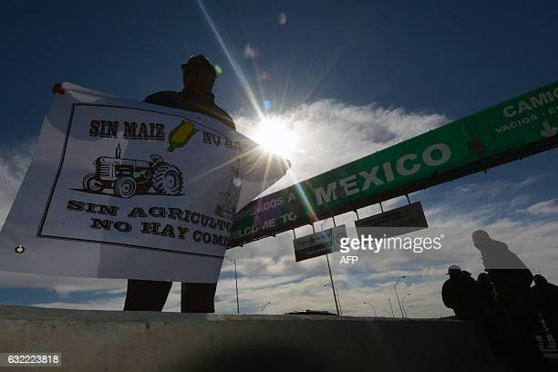 Activists protest against the rise in the price of fuel at the International border in Ciudad Juarez Chihuahua state Mexico on January 20 2017 On...