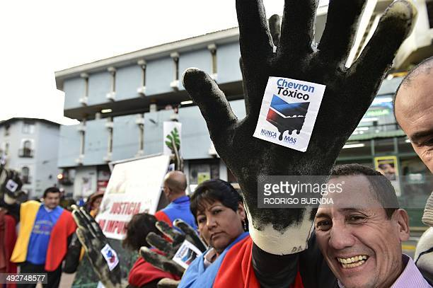 Activists protest against US multinational energy corporation Chevron at a square in Quito on May 21 2014 Ecuadorean ecology groups added Wednesday...