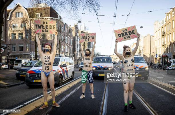 Activists protest during a demonstration by Extinction Rebellion outside the Overtoom in Amsterdam-West, as police move some of the 80 activits on,...