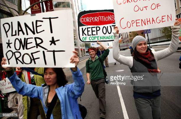 Activists protest during a march against corporations to participate in the upcoming Copenhagen Climate Conference November 30 2009 in Washington DC...