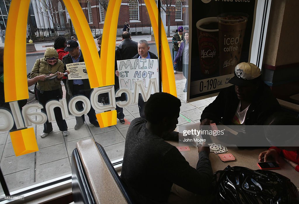 Activists protest for higher wages outside a McDonald's restaurant on April 8, 2014 in Stamford, Connecticut. Demonstrations were organized across the state by Connecticut Working Families to bring attention to minumum wages paid by fast food chains and Wal-Mart stores.
