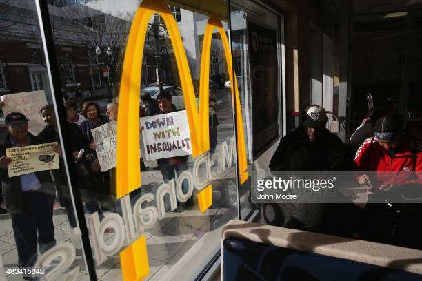 Activists protest for higher wages outside a McDonald's restaurant on April 8 2014 in Stamford Connecticut Demonstrations were organized across the...