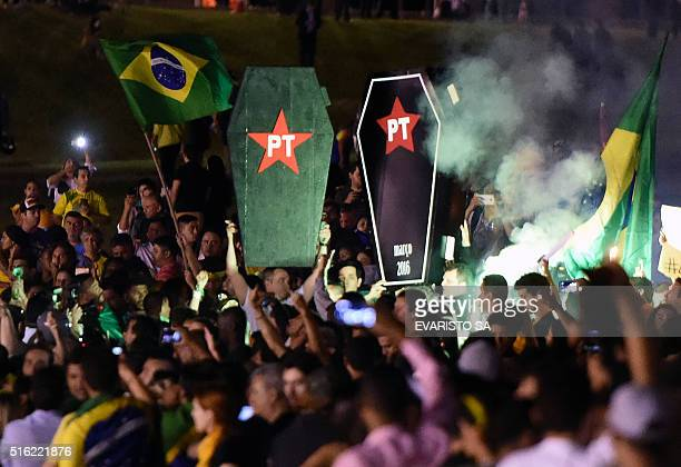 TOPSHOT Activists protest in Brasilia on March 17 2016 Brazilian lawmakers relaunched impeachment proceedings against President Dilma Rousseff...