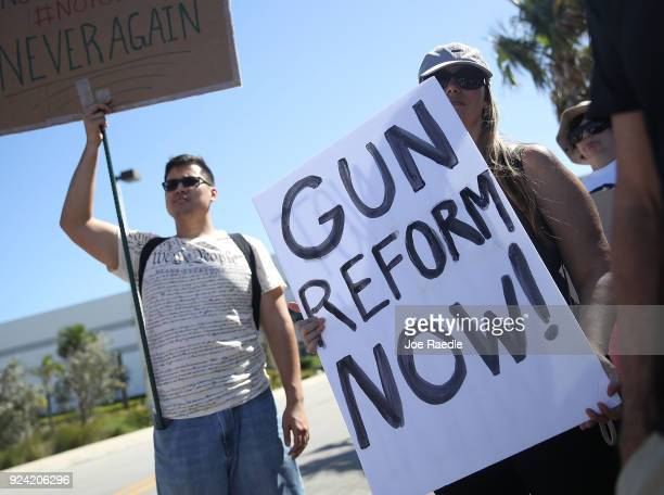 Activists protest in front of Kalashnikov USA a gun manufacturer that makes an AK47 rifle on February 25 2018 in Pompano Beach Florida The protesters...