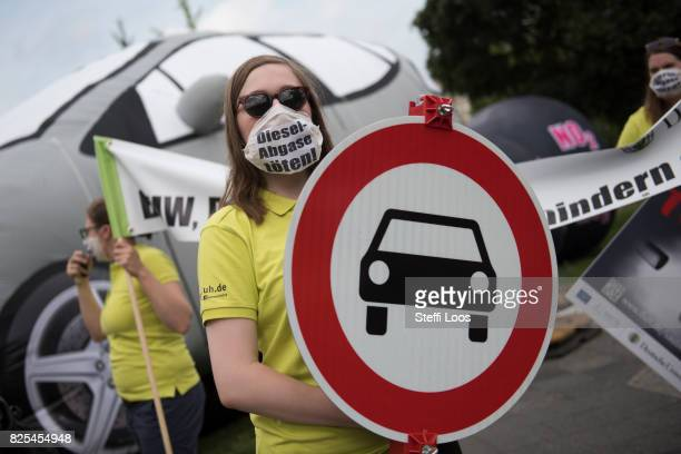 Activists protest in front of the Federal Ministry of Transport and Digital Infrastructure prior to the Diesel Conference on August 2 2017 in Berlin...