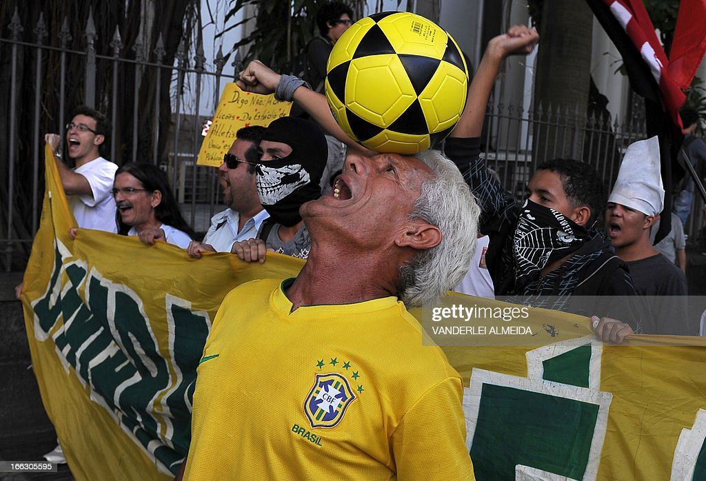 Activists protest in front of the Guanabara state government's palace against the privatization of the Mario Filho 'Maracana' stadium in Rio de Janeiro, Brazil, on April 11, 2013. Bidding for the privatization of Rio's iconic Maracana stadium was to go ahead as planned Thursday after a local court rejected an appeal to block the process. Maracana, which was built for the 1950 World Cup, is undergoing extensive renovation at a cost of 430 million dollars to host four Confederations Cup matches in June as well as seven World Cup games next year, including the finals of both tournaments.