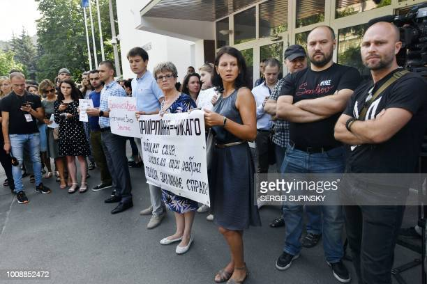 Activists protest in front of the Ukrainian Ministry of Internal Affairs in Kiev on August 1 a day after a shocking acid attack on civil activist...