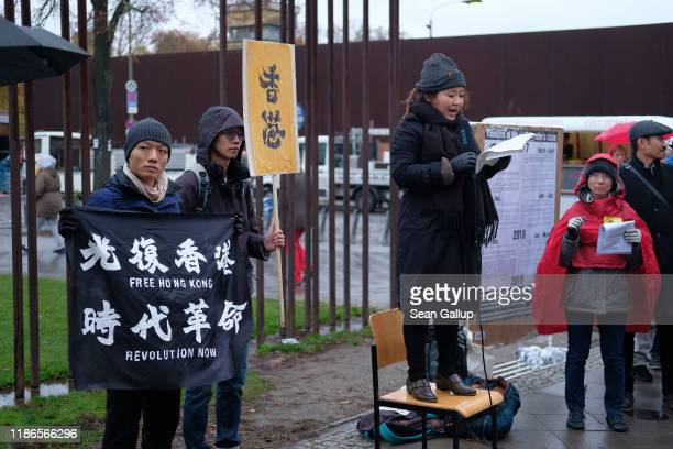 Activists protest in support of prodemocracy demonstrations in Hong Kong at a spot where the Berlin Wall once stood at Bernauer Strasse on the 30th...