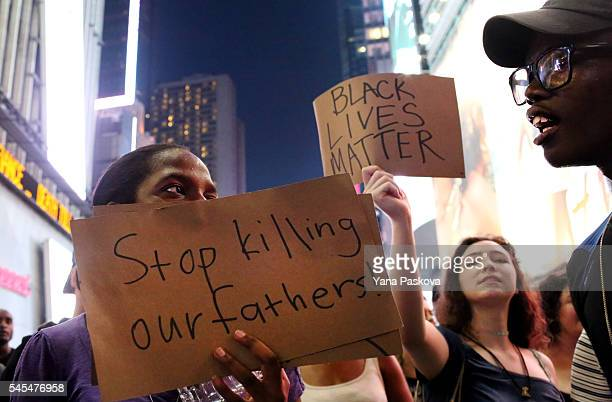 Activists protest in Times Square in response to the recent fatal shootings of two black men by police July 7 2016 in New York City Protests and...