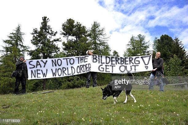 Activists protest on June 9 2011 in front of the Suvretta House fivestar hotel in the chic Swiss ski station of St Moritz where the Bilderberg Group...
